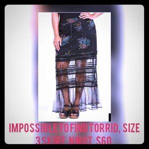 Torrid,  sheer black and floral maxi skirts. 2016